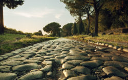 Antique road , Via Appia Antica in Rome, Italy on sunset